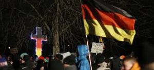 germany protest with cross