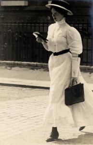 vintage woman walking with bag